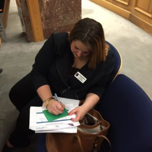 Chez Hope Legal Advocate Taylor Robison signing a Green Card in support of HB525, allowing Hearing Officers in other parishes to sign a Temporary Protective Order when there are no judges available to sign
